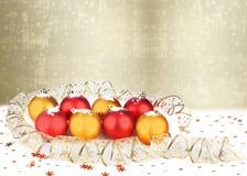 Christmas ball with greeting card Stock Photo