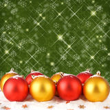 Christmas ball with greeting card on sparkling background Stock Photos