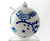 Christmas ball handmade. Painted blue fairy bird. On the stand, close-up stock photography