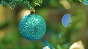 Christmas ball hanging on a branch Christmas and New Year Decoration. Blinking Garland. Christmas Tree Lights Twinkling. Christmas and New Year Decoration stock video