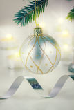 Christmas ball hanging on fir tree Stock Image