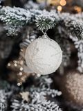 White Christmas ball hanging on frosty fir tree. Merry christmas card. Winter xmas theme. Happy New Year stock image
