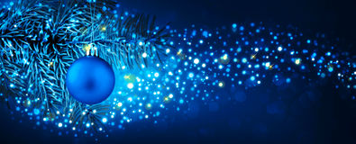 Christmas Ball Hanging On Fir Branch With Festive Bokeh Background. Stock Images