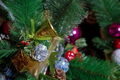 A Christmas ball hangs on the background of a clock. It`s time for a new year. Multicolored glare and brilliance. bell stock photo