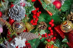 A Christmas ball hangs on the background of a clock. It`s time for a new year. Multicolored glare and brilliance. Pine stock images