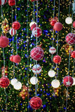 Christmas ball haning on a Christmas tree Stock Photography