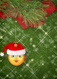 Christmas ball in the hat of Santa Claus Royalty Free Stock Images