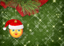 Christmas ball in the hat of Santa Claus Stock Photography