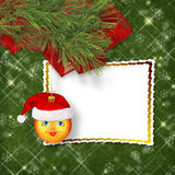 Christmas ball in the hat of Santa Claus Stock Photo