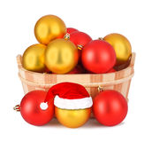 Christmas ball in the hat of Santa Claus Stock Image