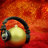Christmas ball with headphones  Royalty Free Stock Image