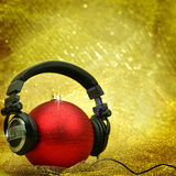 Christmas ball with headphones Royalty Free Stock Photography