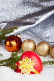 Christmas ball and heart. In a gift Stock Photography