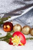 Christmas ball and heart Stock Photography