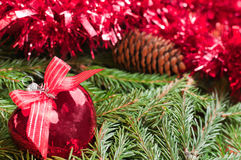 Christmas ball (heart) on fir branch background Royalty Free Stock Images