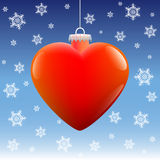 Christmas Ball Heart Snow Stars. Heart shaped christmas ball hanging against a placid winter snowfall background. Vector illustration on blue gradient background Royalty Free Stock Image