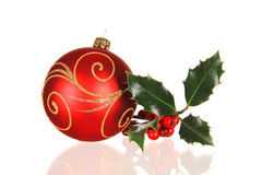 Christmas ball with holly branch Royalty Free Stock Photography