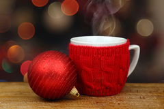 Christmas ball and hot drink Stock Photos