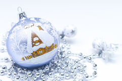 Christmas ball with a house Royalty Free Stock Images