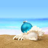 Christmas ball ion the beach Royalty Free Stock Photos