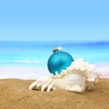 Christmas ball ion the beach royalty free stock photos