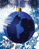Christmas ball with kissing couple. Royalty Free Stock Image