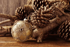 Christmas ball, logs and pine cones Royalty Free Stock Photography