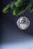 Christmas ball. Luxury christmas ball on christmas tree. Home made Christmas ball hanging on pine twig. Stock Images