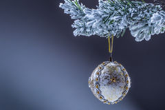 Christmas ball. Luxury christmas ball on christmas tree. Home made Christmas ball hanging on pine twig. Royalty Free Stock Images