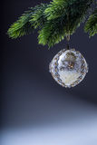 Christmas ball. Luxury christmas ball on christmas tree. Home made Christmas ball hanging on pine twig. Royalty Free Stock Photo