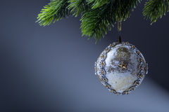 Christmas ball. Luxury christmas ball on christmas tree. Home made Christmas ball hanging on pine twig. Royalty Free Stock Image