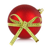 Christmas ball with measuring tape Royalty Free Stock Image
