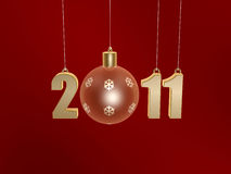 Christmas ball of new year 2011. On red background Stock Photography