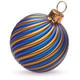 Christmas ball New Year`s Eve decoration blue orange bauble. Christmas ball New Year`s Eve decoration blue orange shiny twisted stripes bauble wintertime hanging Stock Photo