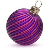 Christmas ball New Year`s Eve decoration blue purple striped. Christmas ball New Year`s Eve decoration blue purple shiny twisted stripes bauble wintertime Royalty Free Stock Photos