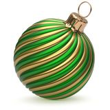 Christmas ball New Year`s Eve decoration green gold twisted. Christmas ball New Year`s Eve decoration green gold shiny twisted stripes bauble wintertime hanging Royalty Free Stock Image