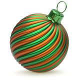 Christmas ball New Year`s Eve decoration green orange bauble. Christmas ball New Year`s Eve decoration green orange twisted stripes bauble wintertime hanging Royalty Free Stock Photo
