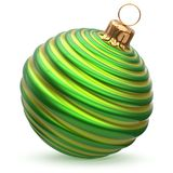 Christmas ball New Year`s Eve decoration green waved bauble. Christmas ball New Year`s Eve decoration green shiny waved striped bauble wintertime hanging Stock Images