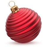 Christmas ball New Year`s Eve decoration red waved bauble. Christmas ball New Year`s Eve decoration red shiny waved bauble wintertime hanging adornment souvenir Royalty Free Stock Photos
