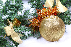 Christmas ball on new year tree branch. In snow Royalty Free Stock Photo