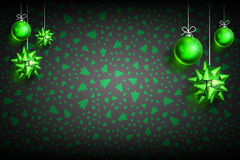 Christmas ball ornament background. Merry Christmas and Happy New Year dark background with Green Christmas Ball and Bow. Christmas related ornaments objects on Stock Photo