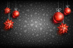 Christmas ball ornament background. Merry Christmas and Happy New Year dark background with Red Christmas Ball and Bow. Christmas related ornaments objects on Royalty Free Stock Image