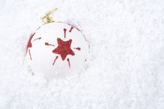 Christmas ball ornament on snow Stock Photos