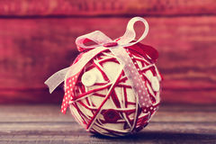 Christmas ball ornamented with ribbons and buttons Royalty Free Stock Image