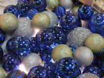 Christmas ball ornaments. Sparkling blues and golds ornaments Royalty Free Stock Images