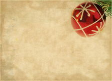 Christmas ball over brown paper. Christmas ball over grunge brown paper background stock photography