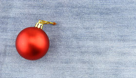Christmas ball over jean background Stock Photo