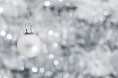 Christmas ball over shiny garland background Royalty Free Stock Photos