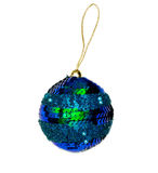 Christmas ball over white. Isolated blue Christmas tree ball with glitters over white royalty free stock photography