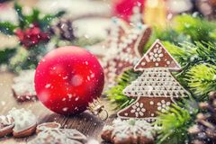 Christmas. Christmas ball pastry gingerbread pine cone and decoration in snowy atmosphere Royalty Free Stock Photos